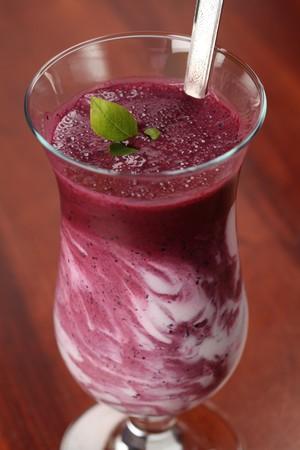 Blueberry milk shake with sour cream. Shallow DOF photo