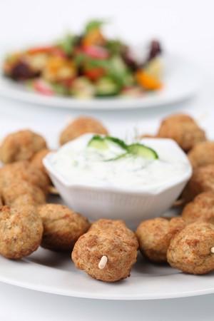 Roast meatballs on skewers and tzatziki dip. Shallow DOF photo