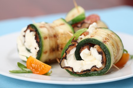 Grilled zucchini rolls with pepper crusted bacon and cheese.