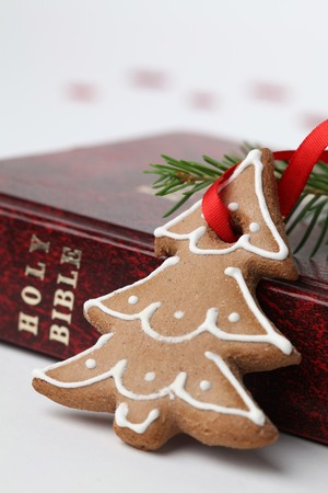 gingerbread cookie: Gingerbread cookie in the shape of Christmas tree on the Bible