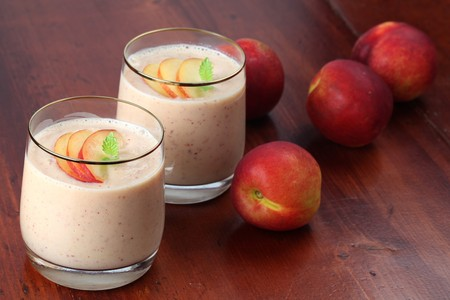 Nectarine milk shake in two glasses photo