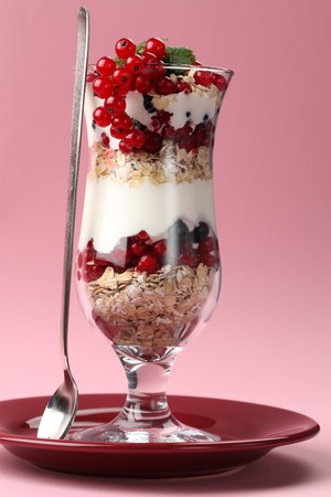 Red and black currant parfait with yogurt and oatmeal photo