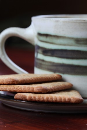 Healthy biscuits and a cup of coffee. Focus on biscuits. Shallow DOF photo