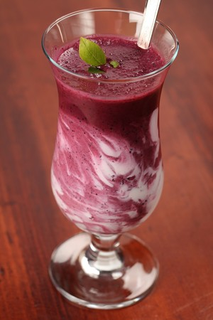 Blueberry milk shake with sour cream. Shallow DOF.  Stock Photo