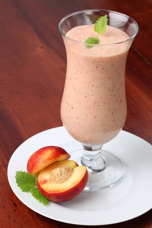 Nectarine milk shake in a glass photo