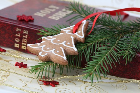 Gingerbread cookie in the shape of Christmas tree on the Bible photo