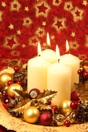 Christmas decoration with four candles on red Christmas background. Stock Photo - 7577456