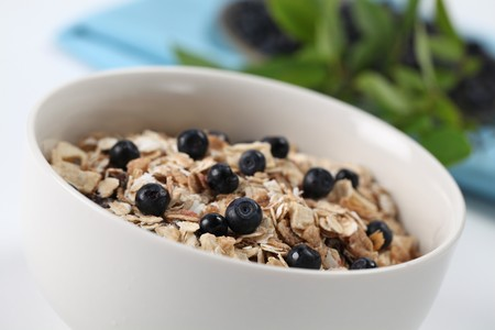wild oats: Granola with fresh wild blueberries.  Stock Photo