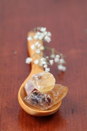 Sugar collection - brown candy sugar with a delicate caramel flavor, suitable for tea, coffee and also mulled wine or punch. It is also ideal for liqueurs and fruits in alcohol. Shallow dof photo