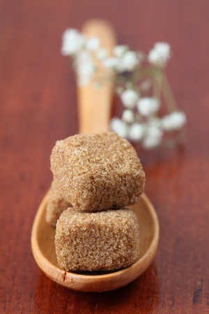 Sugar collection - brown sugar cubes are made from softly compressed brown powdered sugar and melt very quickly. They have delicate caramel flavor and are perfect for Espresso, Cappuccino, Caffé latte and Latte macchiato. Stock Photo - 7714321