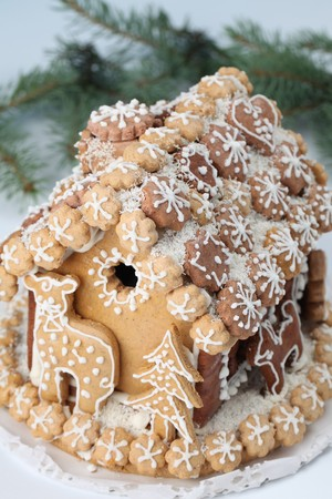 Christmas gingerbread house on white background. photo