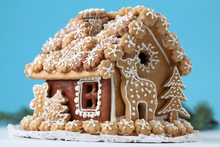Christmas gingerbread house on blue background. Stock Photo - 7714342