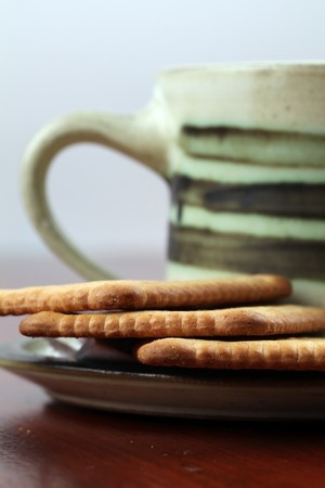 Healthy biscuits and a cup of coffee. Focus on biscuits photo