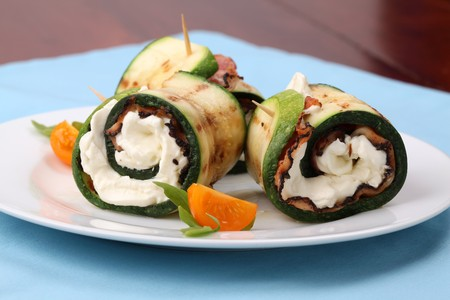 Grilled zucchini rolls with pepper crusted bacon and cheese. Shallow DOF photo