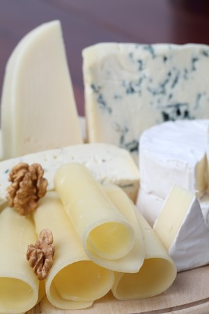Cutting board with various kinds of cheese Stock Photo - 7974439