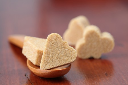 Sugar collection. Brown sugar cubes in shape of card suit. Shallow dof photo