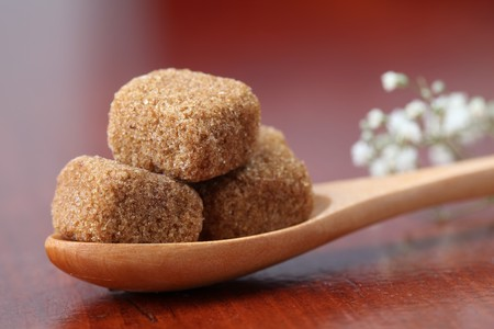 Sugar collection. Brown sugar cubes made from softly compressed brown powdered sugar and melt very quickly. They have delicate caramel flavor and are perfect for Espresso, Cappuccino, Caffe latte and Latte macchiato.