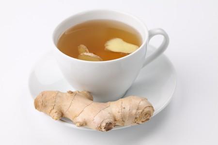Ginger tea on white background. Shallow dof photo