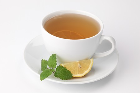 lemon balm: Healthy lemon balm tea with lemon Stock Photo