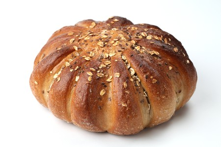 breadloaf: Loaf of wholemeal bread on white background. Shallow dof
