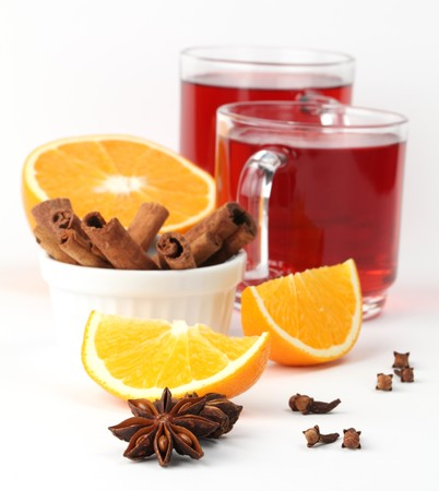 halved  half: Mulled wine with oranges, cinnamon, anise and clove on white background Stock Photo