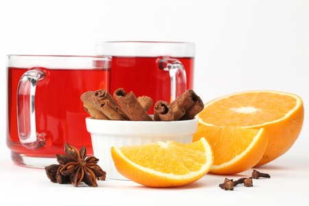 Mulled wine with oranges, cinnamon, anise and clove on white background photo