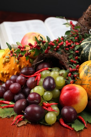 Thanksgiving arrangement with cornucopia and the Bible in background Stock Photo - 8043678