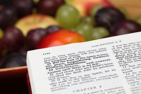 verse: Holy Bible open to Galatians 5. Focus on verse 22. Fruit of the Spirit