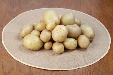 straw mat: Close-up of fresh organic potatoes on a straw mat. Shallow dof Stock Photo