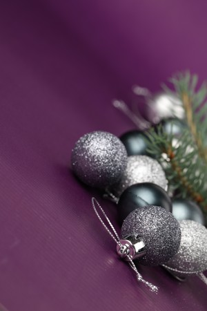 silver christmas ornaments on purple background copy space stock photo 8043662