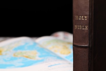 evangelism: Holy Bible and a world map in the background. World missions concept. Copy space. Stock Photo