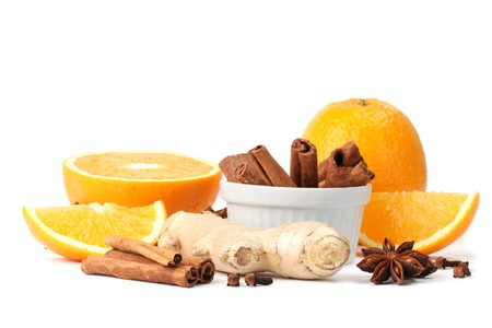 Ingredients for winter hot drink. Orange with cinnamon, ginger, anise and clove isolated on white background photo