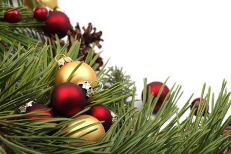 Christmas arrangement with red and gold ornaments isolated on white background. Shallow dof photo