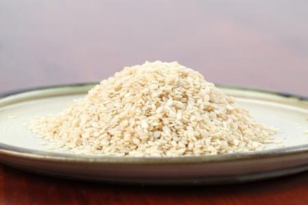 white sesame seeds: White sesame seeds on a plate Stock Photo