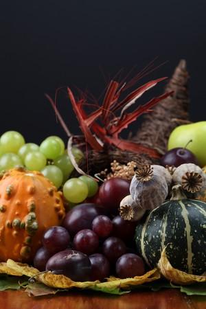 harvest cone cornucopia: Autumn cornucopia - symbol of food and abundance Stock Photo