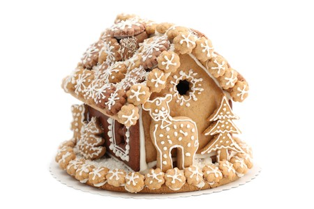 Christmas gingerbread house isolated on white background. Shallow dof photo