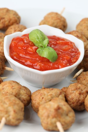 Roast meatballs on skewers and tomato dip. Shallow DOF photo
