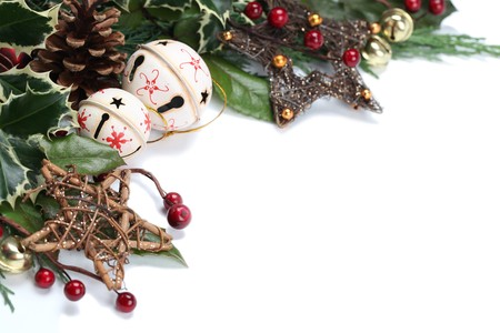 Christmas border with jingle bells, stars and other Christmas ornaments and decorations isolated on white. Shallow dof