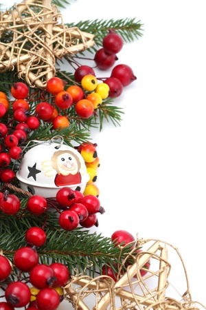 Christmas border with jingle bell, stars and berries isolated on white background. Shallow dof photo