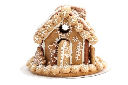 Christmas gingerbread house isolated on white background. Shallow dof photo