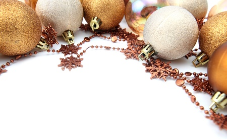 Christmas border with gold and brown ornaments isolated on white background. Shallow dof