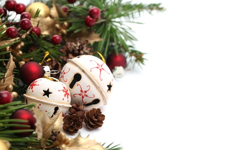 Christmas border with jingle bells and other Christmas ornaments and decorations isolated on white. Shallow dof Stock Photo - 8229582
