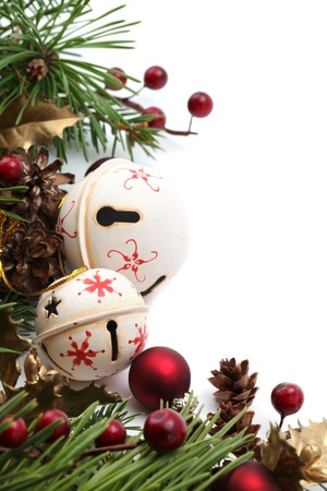 jingle: Christmas border with jingle bells and other Christmas ornaments and decorations isolated on white. Shallow dof Stock Photo