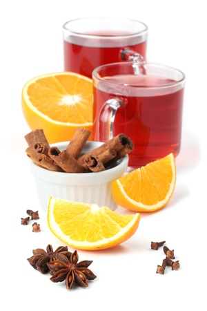 mulled: Mulled wine with oranges, cinnamon, anise and clove isolated on white background. Shallow dof Stock Photo