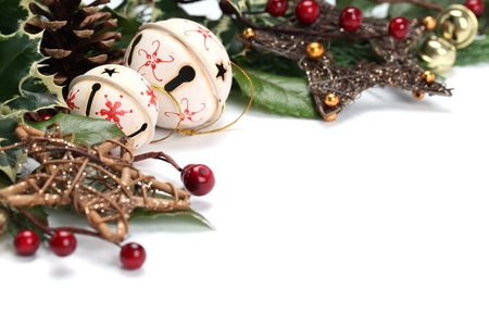 Christmas border with jingle bells, stars and other Christmas ornaments and decorations isolated on white. Shallow dof Stock Photo - 8337591