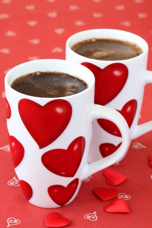 Coffee with hearts on a red background photo