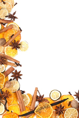 Christmas frame with Christmas spices and dried orange slices isolated on white background photo