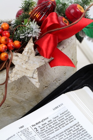religious text: Open Bible with selective focus on text in Lucas 2 about Jesus birth Stock Photo