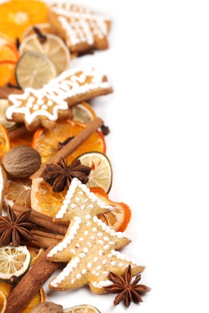 Christmas frame with gingerbread cookies, Christmas spices and dried orange slices isolated on white background photo