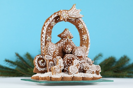 Gingerbread nativity scene on blue background. Shallow dof photo